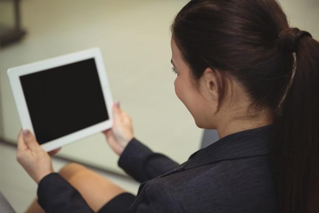 Attentive businesswoman using digital tablet