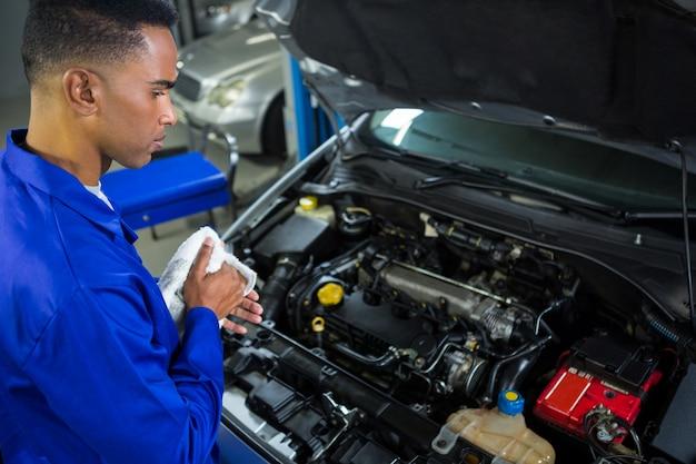 Attentive mechanic servicing car