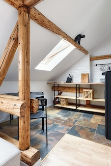 Attic apartment modern kitchenapartment interior design with old rustic wooden beams and furniture