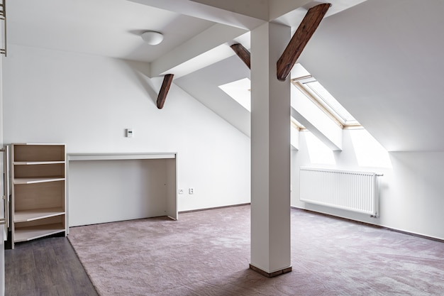 Attic apartment with furniture in a modern building