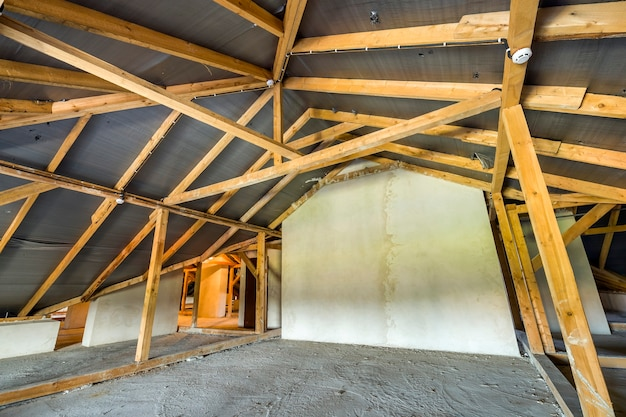 Attic of a building with wooden beams of a roof structure.