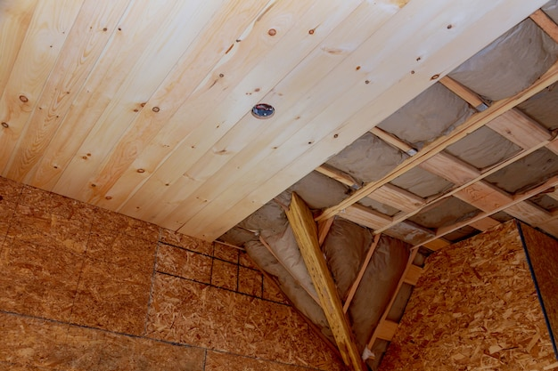 Attic with fiberglass insulation frame house in process of construction