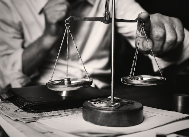 Attorney with scale on the table