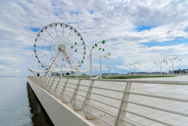 Attraction ferris wheel installed on the embankment of baku seaside boulevard