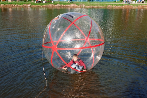 Attraction water, zorb,  boy in a bowl water