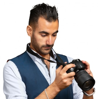 Attractive adult man with a camera isolated