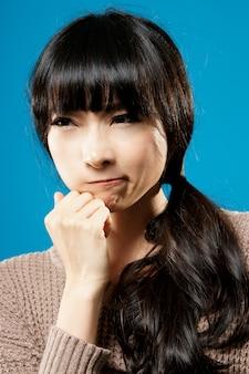 Attractive asian beauty thinking, closeup portrait