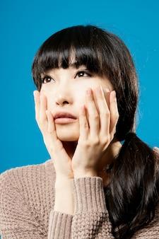 Attractive asian beauty wishing, closeup portrait