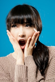 Attractive asian beauty with surprised expression