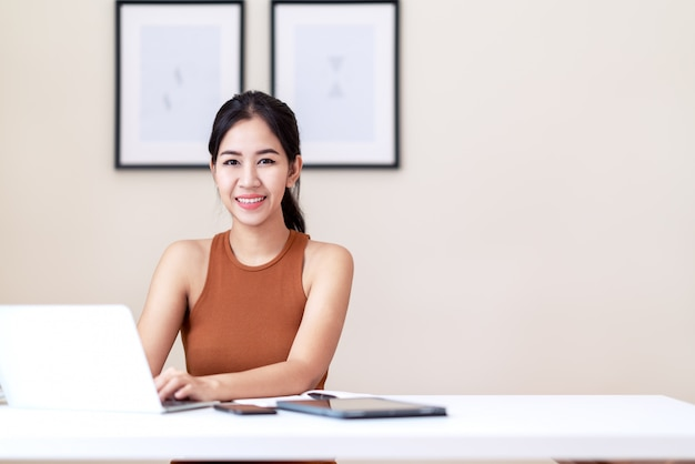 Attractive asian entrepreneur woman