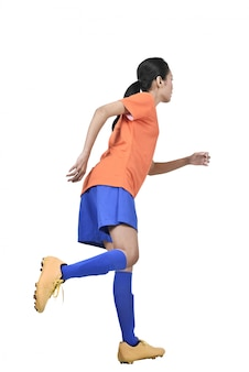 Attractive asian female football player kicking