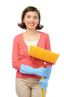 Attractive asian woman with broom