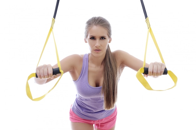 Attractive athlete woman isolated