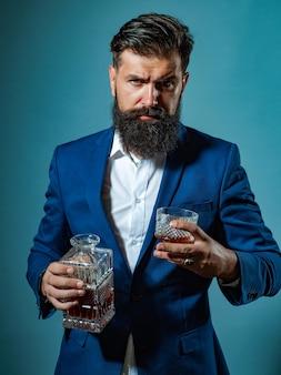 Attractive bartender in whiskey bar degustation of elite alcohol