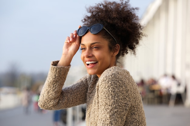 Attractive black woman smiling outdoors