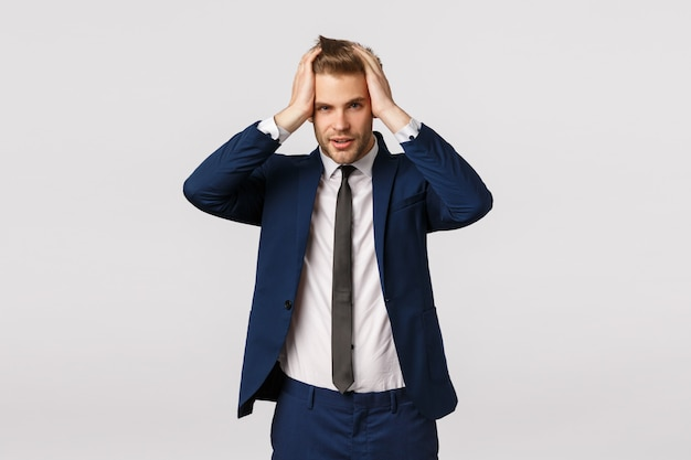 Attractive blond bearded businessman with his hands on his head