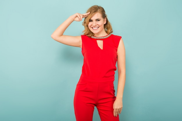 Attractive blonde woman in red overalls