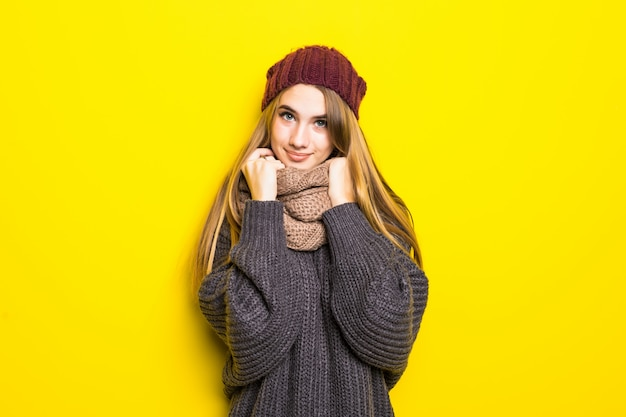 Attractive blonde woman in warm sweater is ill flu cold and try to warm up