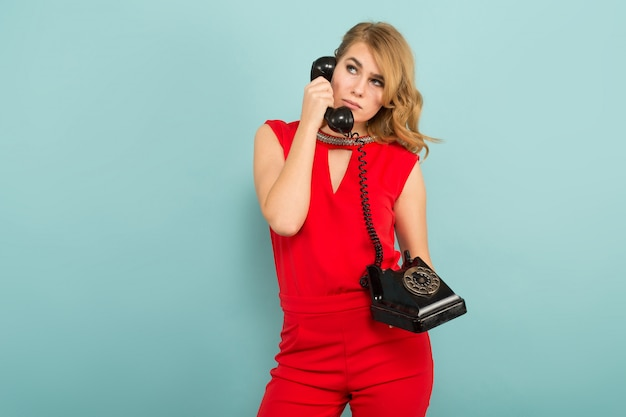 Attractive blonde woman with telephone