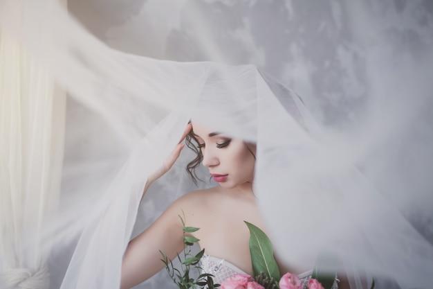 Attractive bride with a bouquet