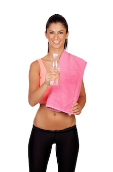 Attractive brunette girl drinking water during training the isolated on a white background