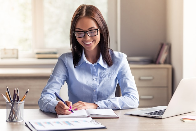 Attractive business lady in formal clothes and eyeglasses.