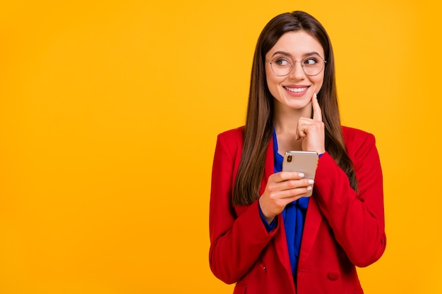 Attractive business lady hold telephone hands look side