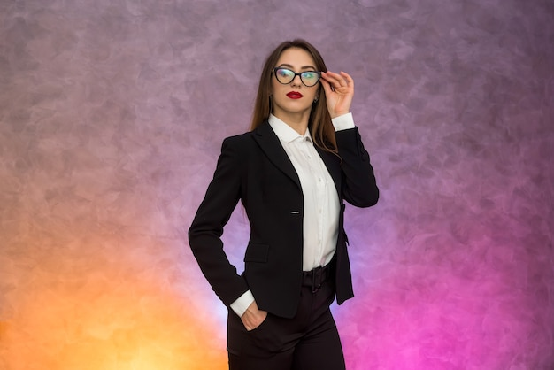 Attractive business woman gesturing ob abstract background in original spectacles
