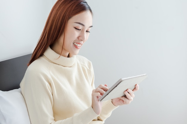 Attractive business woman use computer tablet to see her online store