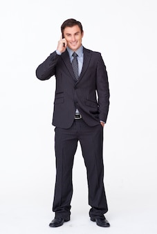 Attractive businessman on phone against white