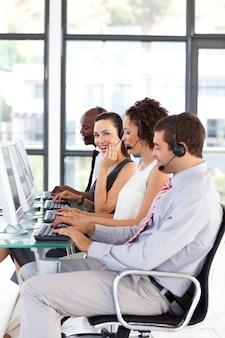 Attractive businesswoman in a call center