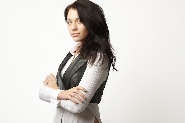 Attractive businesswoman in fashion suit with her arms crossed