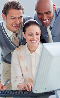 Attractive businesswoman and her colleagues working at a computer