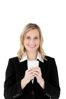 Attractive businesswoman holding a drinking cup