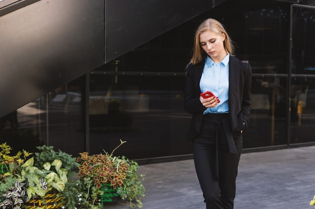 Attractive businesswoman outside the office building