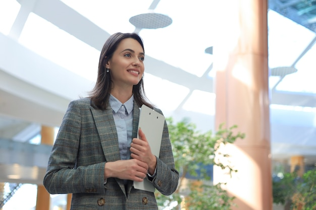 Attractive businesswoman standing in the office area.