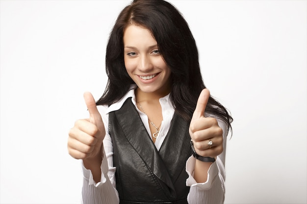 Attractive businesswoman with her thumbs raised up