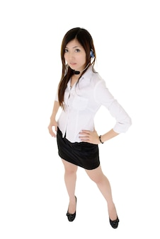 Attractive call center business lady standing, full length portrait isolated over white.