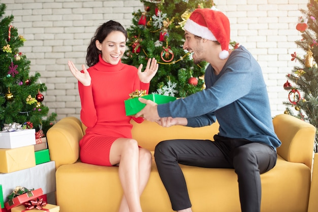 Attractive caucasian couple of love are  celebrating christmas in home