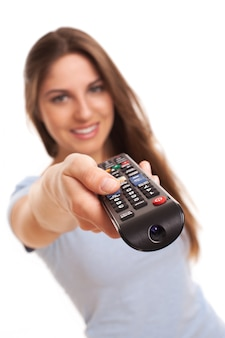 Attractive caucasian woman with  tv remote