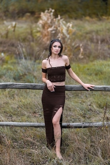 Attractive confident young girl in a beautiful evening dress