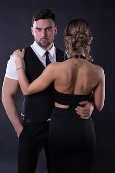 Attractive couple in formal attire isolated