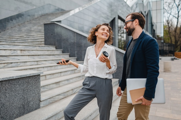 Attractive couple of man and woman talking in urban city center