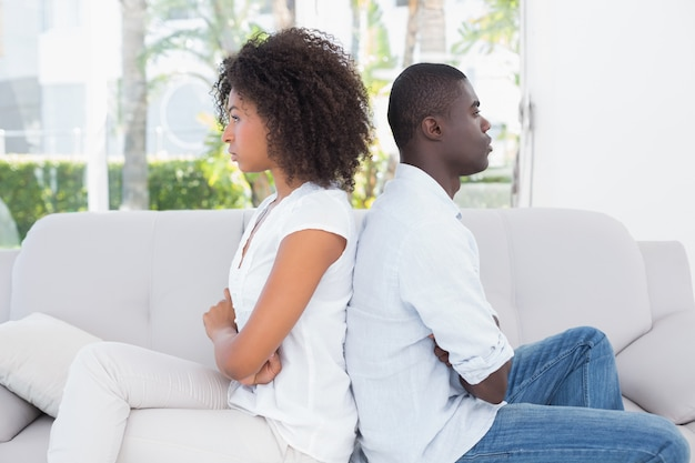 Attractive couple not talking on the couch