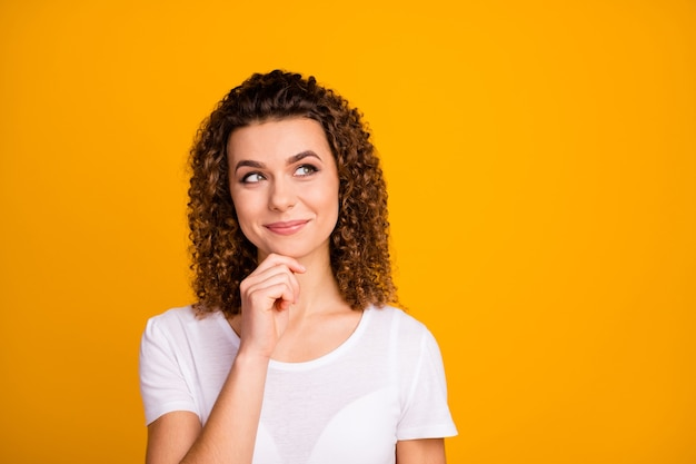 Attractive cute lady arm on chin thinking look empty space