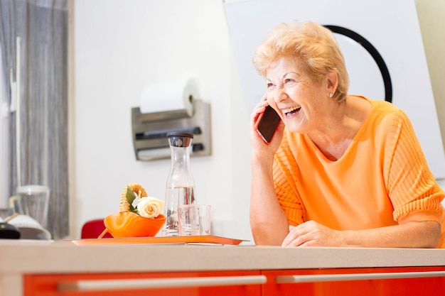 Attractive elderly spanish woman smiling in your home