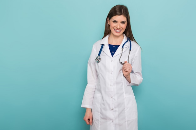 Attractive female doctor in white coat
