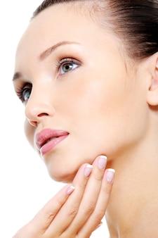 Attractive female face in skincare treatment concept