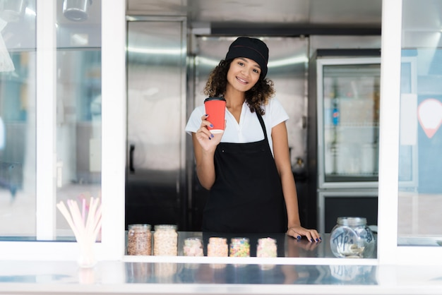 Attractive female seller posing in a mobile diner.