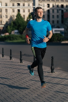 Attractive fit man running in the city